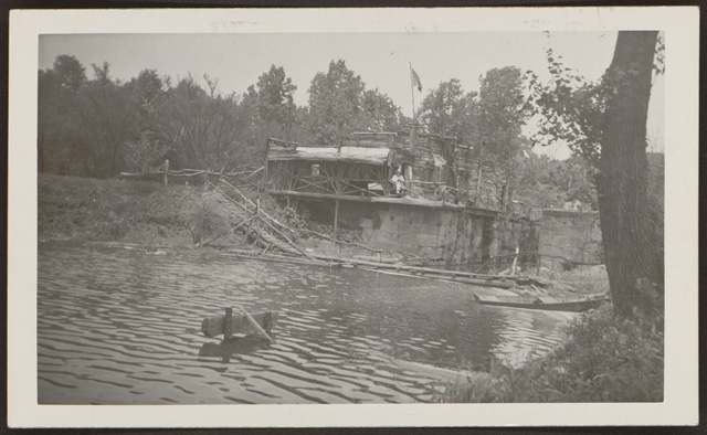 Photograph of Captain Pearl R. Nye Sitting Outside Camp Charming