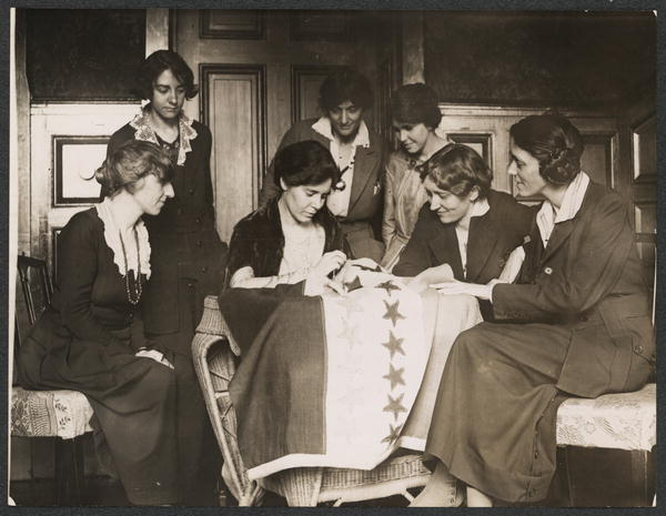National Photo Co, W. (1919) [National Woman's Party activists watch Alice Paul sew a star onto the NWP Ratification Flag, representing another state's ratification of the 19th Amendment]. United States Washington D.C. [Photograph] Retrieved from the Library of Congress
