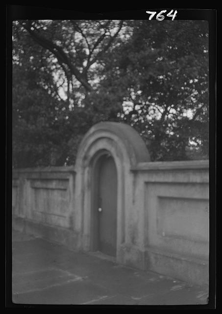 Arched doorway in a free-standing wall, New Orleans or Charleston, South Carolina
