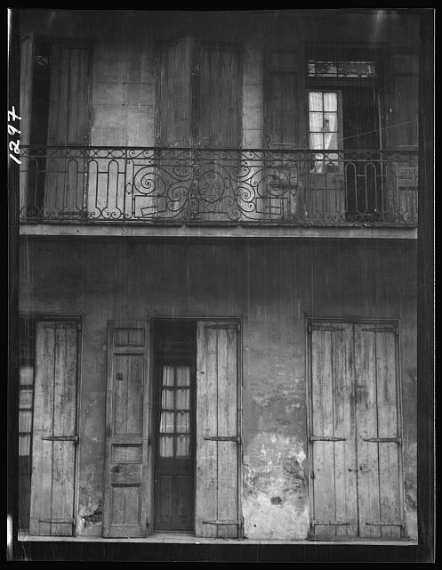 Facade of a building with shuttered doors and balcony, New Orleans or Charleston, South Carolina