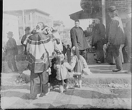 Women and children crossing a street, Chinatown, San Francisco