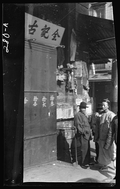 Two men standing on a sidewalk, Chinatown, San Francisco