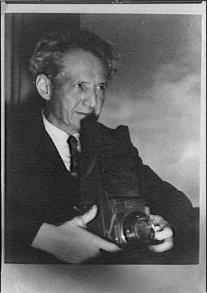 Arnold Genthe holding a camera