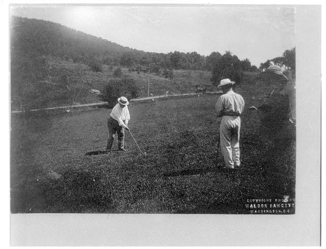 President W.H. Taft putting on the golf course