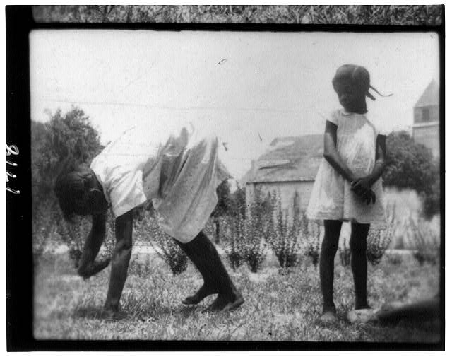 [Children playing and sitting outdoors, Eatonville, Florida]