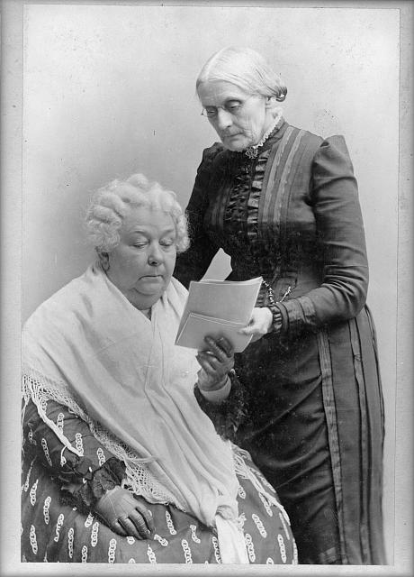 [Elizabeth Cady Stanton, seated, and Susan B. Anthony, standing, three-quarter length portrait]