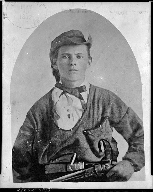 [Jesse James, half-length portrait, facing front, holding handgun in left hand at his waist]