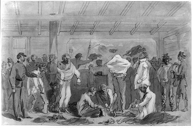 Returned prisoners of war exchanging their rags for new clothing on board Flag of Truce boat New York