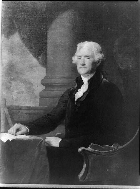 [Thomas Jefferson, three-quarter length portrait, seated at table, facing left]