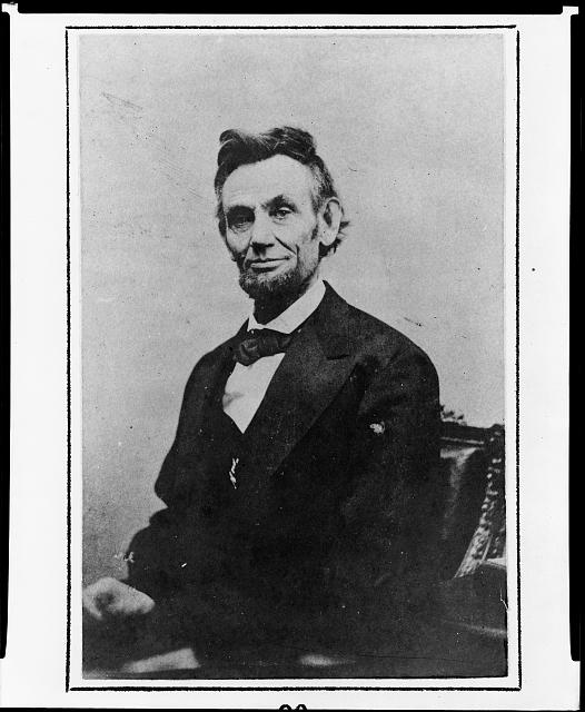 [Abraham Lincoln, half-length, seated, with empty hands]