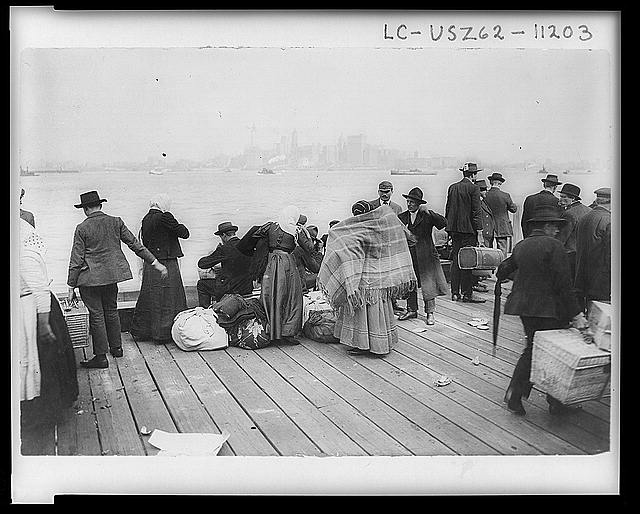 Immigrants waiting to be transferred, Ellis Island, October 30, 1912