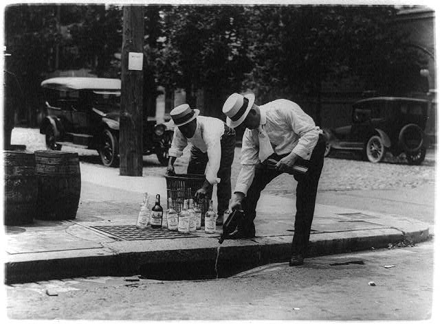 Pouring whiskey into a sewer