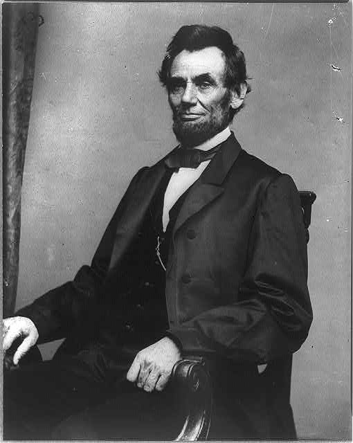 [Abraham Lincoln, three-quarter length portrait, seated]
