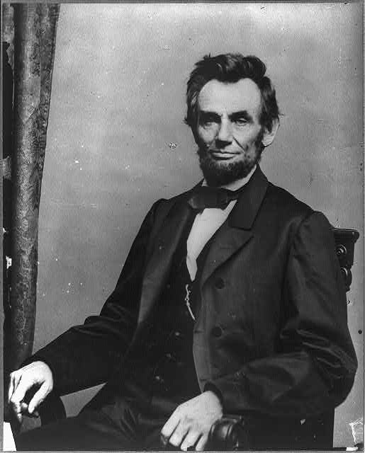 [Abraham Lincoln, three-quarter length portrait, seated, facing front]