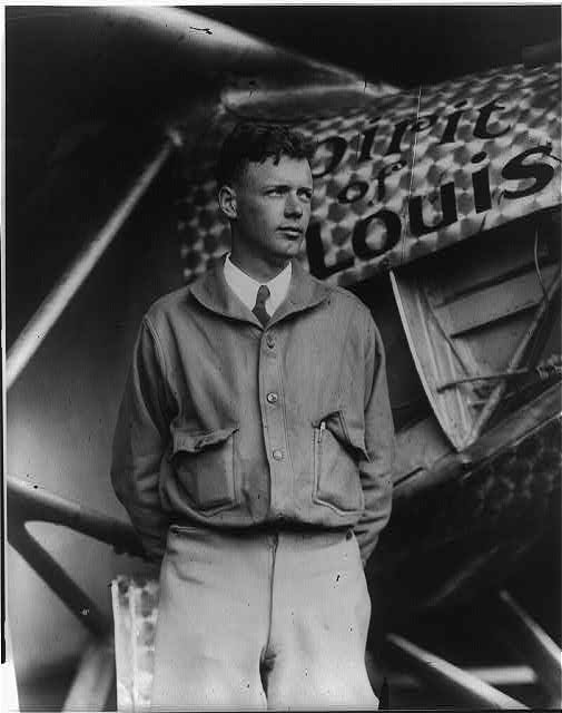 Charles A. Lindbergh, with Spirit of St. Louis in background, May 31, 1927