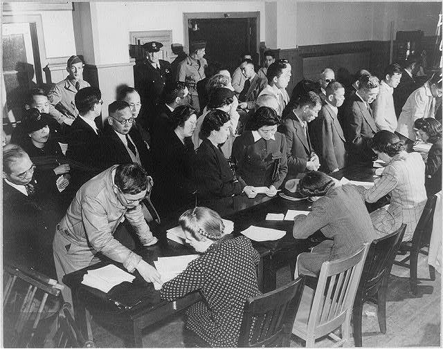 Residents of Japanese descent registering for evacuation at the Wartime Civil Control Administration station, San Francisco, April, 1942