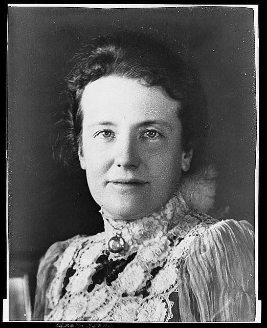 [Mrs. Theodore Roosevelt, three-quarters length portrait, seated at desk, facing forward]