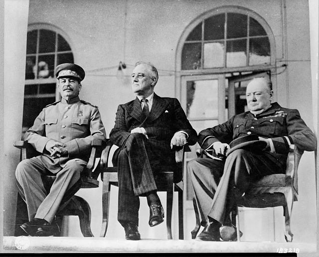 Roosevelt, Stalin, and Churchill on portico of Russian Embassy in Teheran, during conference--Nov. 28 - Dec. 1, 1943