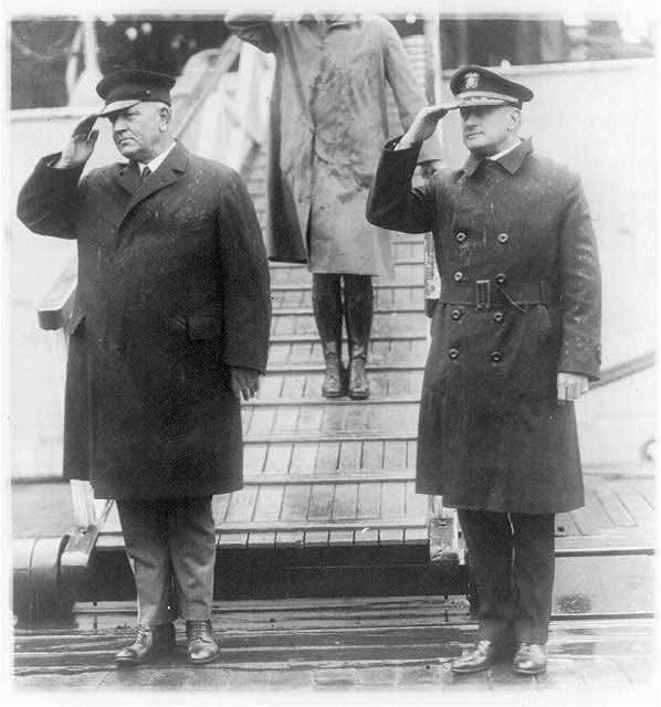 Secty. of Navy Denby and his aide snaped [sic] on their arrival in Wash. today