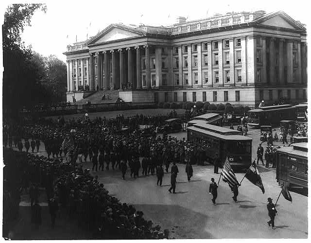 [G.A.R. marching in Grant memorial parade, Washington, D.C., looking across Pennsylvania Ave to Treasury building]