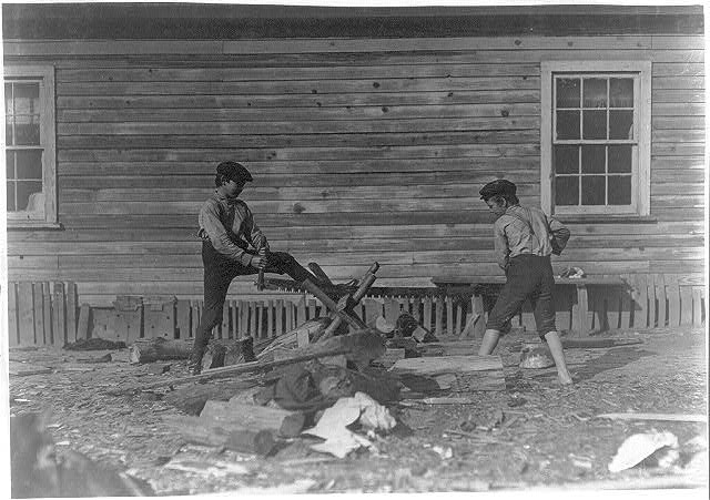 Boys working in Maple Mill, Dillon, S.C. Pete Dunlap (smaller). Said 11 years old. Mannings Dunlap. Both doff--40 cents a day.  Location: Dillon, South Carolina.