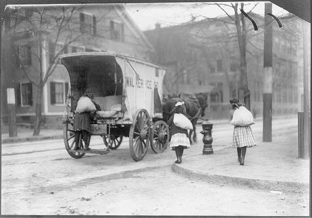 [Girls working on ice wagon.]  Location: New York, New York (State)
