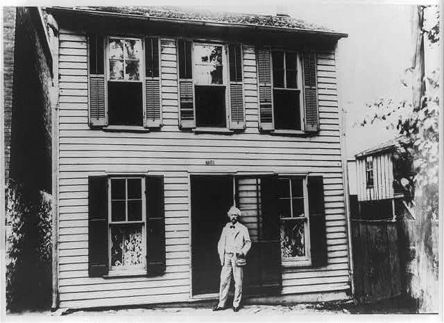 "The boyhood home of the American writer Mark Twain was this gray house on Hill Street, Missouri, the house described as Tom Sawyer's home in Mark Twain's best known story, ""The Adventures of Tom Sawyer"""