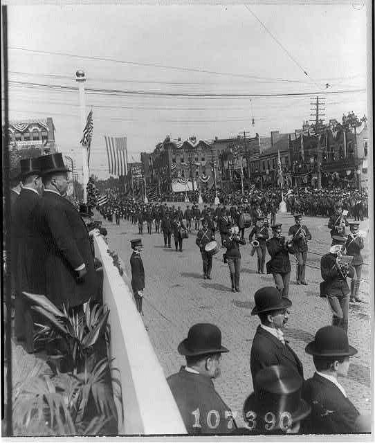 [President Theodore Roosevelt, with the Mayor of Canton and the Gov. of Ohio, reviewing parade on McKinley Memorial Day, Canton, Ohio, Sept. 30, 1907]