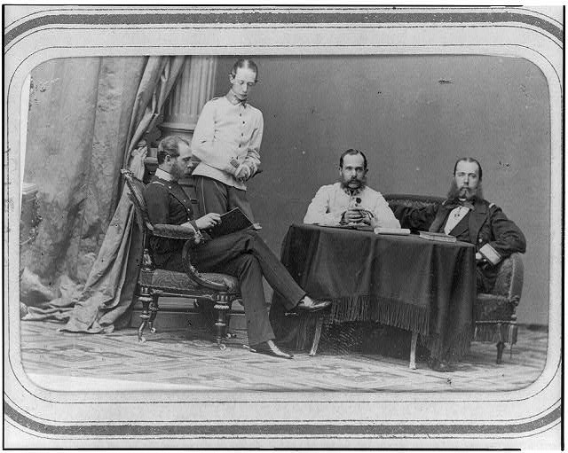 [Emperor Maximilian, seated, far right, and three other men, in Vienna]