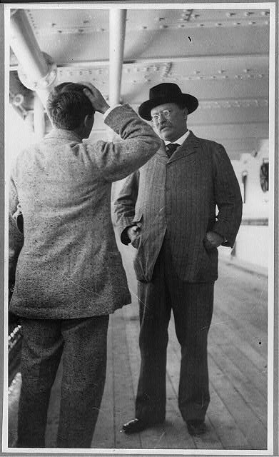 [Theodore Roosevelt in conversation with G. Gardner aboard the SS Kaiserin Auguste Victoria]