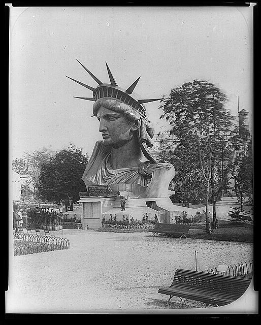 [Head of Statue of Liberty on display in park in Paris]
