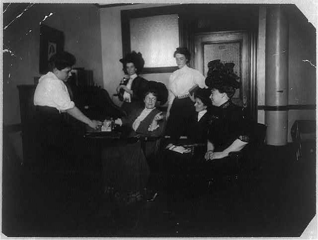 Suffragette headquarters, 32 Union Square, NYC. Mrs. Harriot Blatch seated with Miss Weiss and others