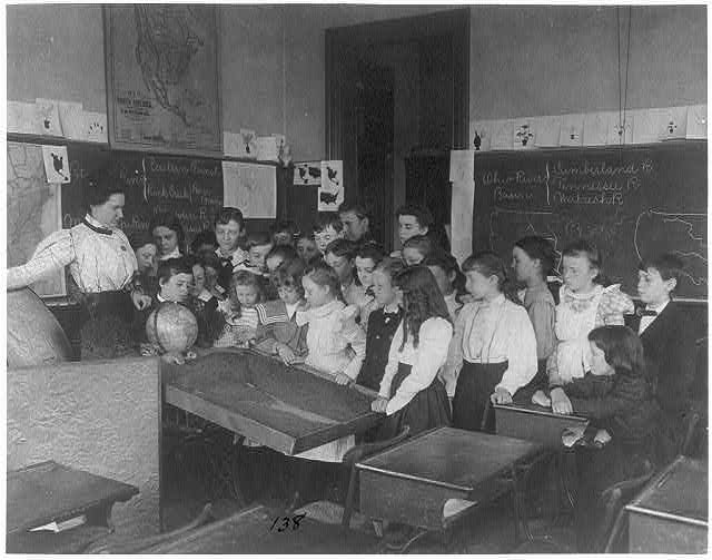 [Washington, D.C. public school classroom scenes - 1st Division geography class - students examining relief map]