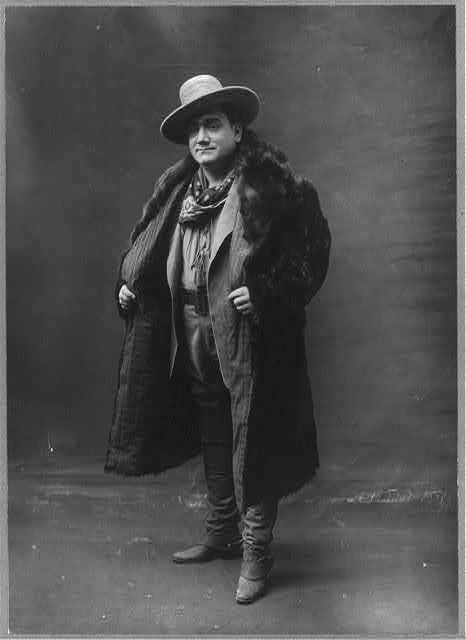 "[Enrico Caruso, 1873-1921, In ""Girl of the Golden West"", full length portrait, standing, wearing full coat, facing slightly left]"