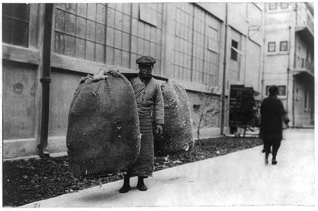 A Chinese man carrying cotton [200 lbs.], Shanghai