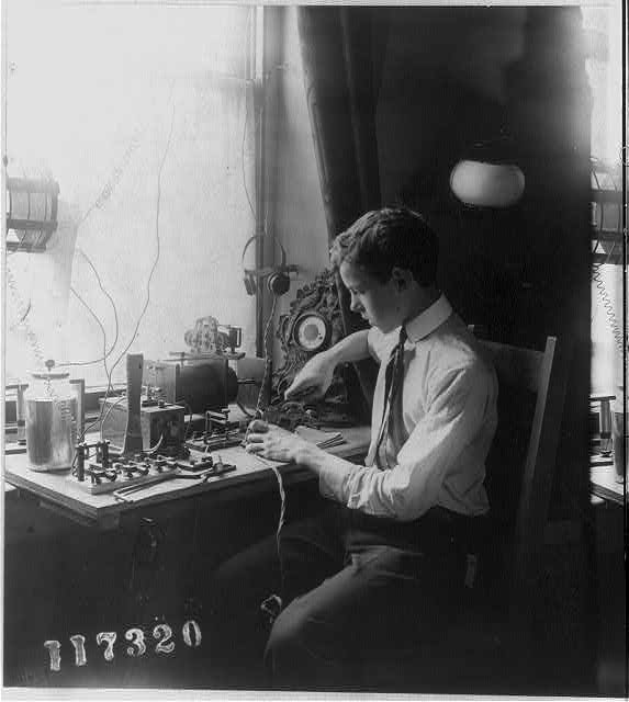Boy working with electrical apparatus [telegraph]