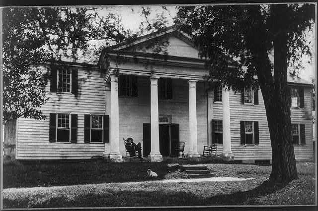 """Fort Hill,"" residence of John C. Calhoun, Oconee County, South Carolina: man seated on porch"