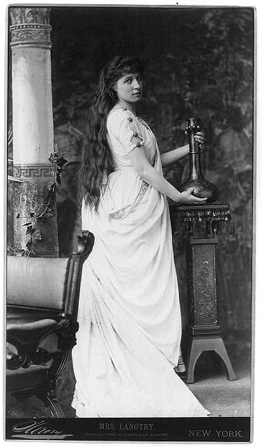 [Lillie Langtry, 1853-1929, full-length portrait, standing, facing right, holding vase on stand]