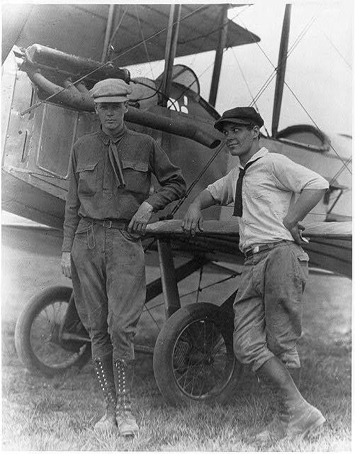 "[Lindbergh and Harlan ""Bud"" Gurney standing by plane at Lambert Field, St.Louis, Missouri]"