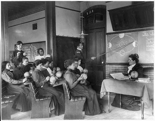 [A class in mathematical geography studying earth's rotation around the sun, Hampton Institute, Hampton, Virginia]