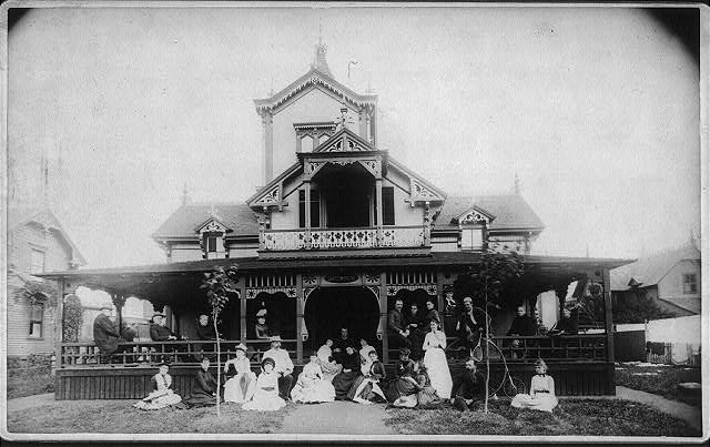 "[27 men and women (Johnston family) in front of beach house ""Dartmouth""]"