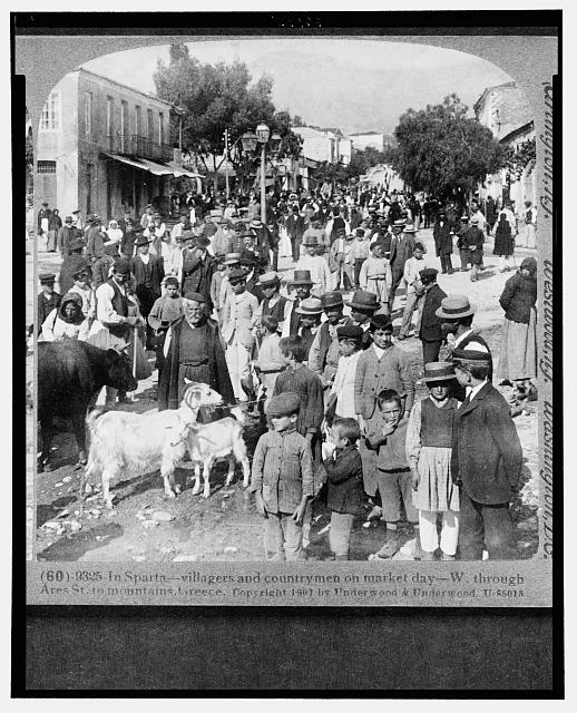 In Sparta - villagers and country men on market day - W. through Ares St. to mountains, Greece