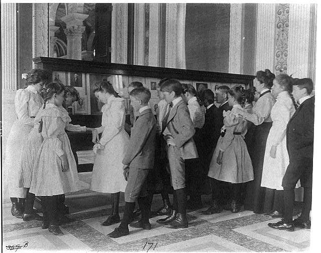 [Washington, D.C. public schools - museum field trip - viewing exhibit case of George Washingtoniana]