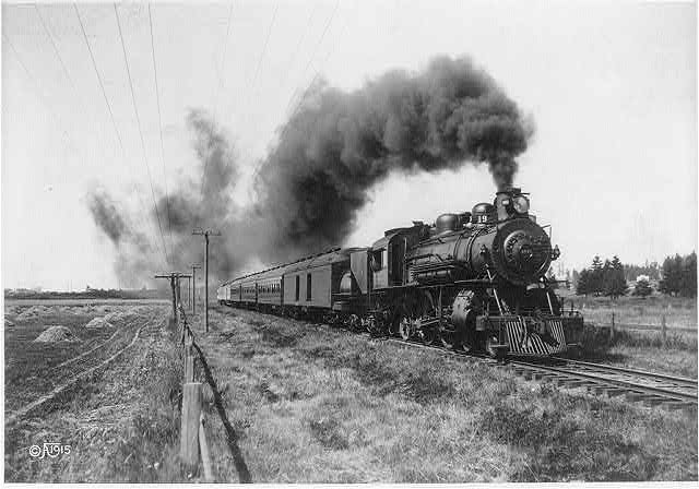 [Railroad train with locomotive in foreground]