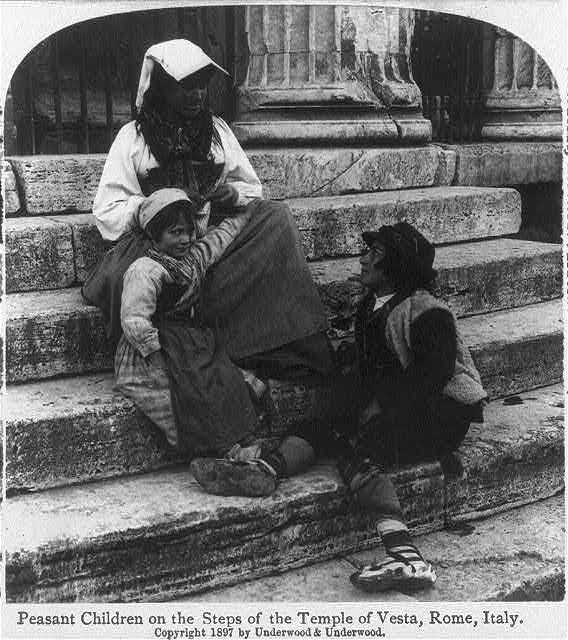 Peasant children on the steps of the Temple of Vesta, Rome, Italy
