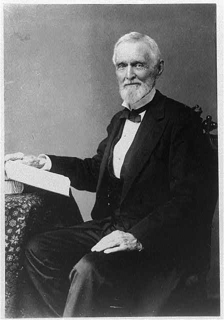 [Jefferson Davis, seated with hand on open book, facing front]