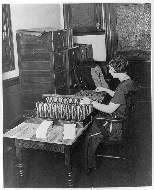 Young woman at work with sorting machine in the office of Everett G. Clements, National Assorting Co., Washington, D.C.
