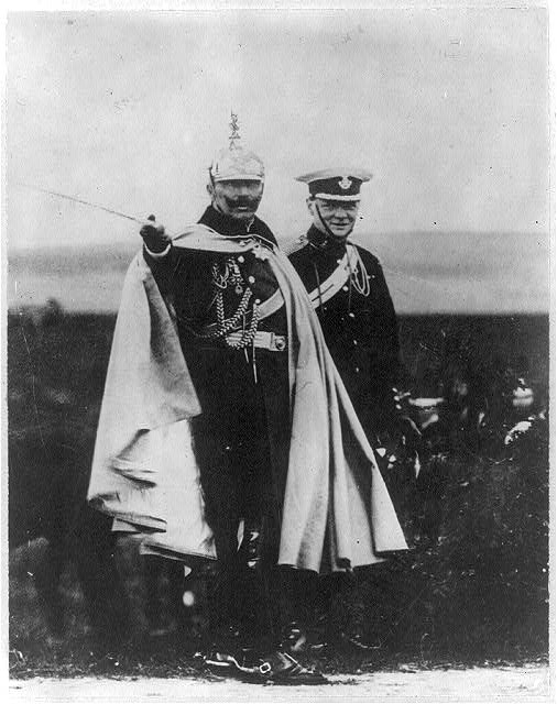 [Winston Churchill with Kaiser Wilhelm at German Army maneouvers. Both standing, full lgth., in uniforms; Kaiser Wilhelm pointing with sword.]