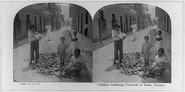 Children gathering firewood in street, Panama [City]