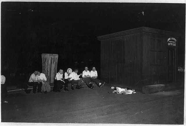 [N.Y.C. - people sitting on pier at night during hot weather, 2 small children sleeping]